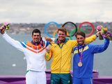 Gold medallist Tom Slingsby (C) of Australia celebrates with silver medallist Pavlos Kontides (L) of Cyprus and bronze medallist Rasmus Myrgren (R) of Sweden following the Men's Laser Sailing on Day 10 of the London 2012 Olympic Games at the Weymouth & Portland Venue at Weymouth Harbour on August 6, 2012 in Weymouth, England.