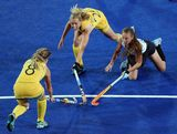 Ashleigh Nelson and Fiona Boyce of Australia contest for the ball with Florencia Habif of Argentina during the Women's Hockey match between Argentina and Australia on Day 10 of the London 2012 Olympic Games at Riverbank Arena Hockey Centre on August 6, 2012 in London, England.