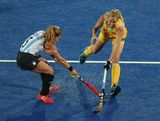Macarena Rodriguez Perez of Argentina and Fiona Boyce of Australia contest for the ball whilst being tackled by Rosario Luchetti of Argentina during the Women's Hockey match between Argentina and Australia on Day 10 of the London 2012 Olympic Games at Riverbank Arena Hockey Centre on August 6, 2012 in London, England.