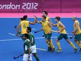 Liam De Young of Australia celebrates scoring the first goal during the Men's Hockey match between Australia and Pakistan on Day 11 of the London 2012 Olympic Games at Riverbank Arena Hockey Centre on August 7, 2012 in London, England.