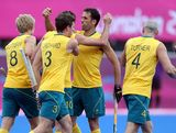 Russel Ford of Australia is congratulated by Mark Knowles after scoring a goal during the Men's Hockey match between Australia and Pakistan on Day 11 of the London 2012 Olympic Games at Riverbank Arena Hockey Centre on August 7, 2012 in London, England.