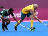 Glenn Turner of Australia battles with Muhammad Imran of Pakistan during the Men's Hockey match between Australia and Pakistan on Day 11 of the London 2012 Olympic Games at Riverbank Arena Hockey Centre on August 7, 2012 in London, England.