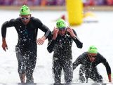 Felipe Van De Wyngard of Chile and Brendan Sexton of Australia compete in the swim portion of the Men's Triathlon during the Men's Triathlon on Day 11 of the London 2012 Olympic Games at Hyde Park on August 7, 2012 in London, England.