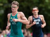 Brad Kahlefeldt of Australia leads Stuart Hayes of Great Britain during the running portion of the Men's Triathlon on Day 11