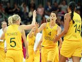 Jenna O'Hea #4 of Australia high fives Samantha Richards #5 and Liz Cambage #14 after scoring against China during the Women's Basketball quaterfinal on Day 11 of the London 2012 Olympic Games at the Basketball Arena on August 7, 2012  in London, England.
