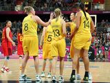Australia celebrates after scoring against China during the Women's Basketball quaterfinal on Day 11 of the London 2012 Olympic Games at the Basketball Arena on August 7, 2012  in London, England.