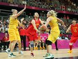 Zengyu Ma #11 of China is fouled as she attempts a shot against Lauren Jackson #15 of Australia during the Women's Basketball quaterfinal on Day 11 of the London 2012 Olympic Games at the Basketball Arena on August 7, 2012  in London, England.