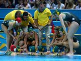 Coach Greg McFadden of Australia talks with his players against the United States during the Women's Water Polo semifinal match at the Water Polo Arena on August 7, 2012 in London, England.