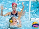 Glencora Ralph of Australia and Maggie Steffens (underwater) of the United States compete for the ball in the Women's Water Polo semifinal match between Australia and the United States at the Water Polo Arena on August 7, 2012 in London, England.