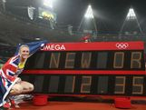Sally Pearson poses next to the timing screen after setting a new Olympic record of 12.35 in the Women's 100m Hurdles Final on Day 11 of the London 2012 Olympic Games at Olympic Stadium on August 7, 2012 in London, England.