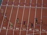 Sally Pearson crosses the finish line ahead of Dawn Harper and Kellie Wells of the United States to win the Women's 100m Hurdles Final on Day 11 of the London 2012 Olympic Games at Olympic Stadium on August 7, 2012 in London, England.