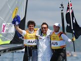 Nathan Outteridge (R) and Iain Jensen (L) of Australia celebrate with their coach Emmett Lazich (C) after winning gold in the Men's 49er Sailing on Day 12 of the London 2012 Olympic Games at the Weymouth & Portland Venue at Weymouth Harbour on August 8, 2012 in Weymouth, England.
