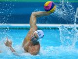 Sam McGregor #8 of Australia throws the ball in the Men's Water polo quarterfinal match between Australia and Serbia on Day 12 of the London 2012 Olympic Games at Water Polo Arena on August 8, 2012 in London, England.