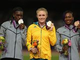 (L-R) Silver medalist Dawn Harper of the United States, gold medalist Sally Pearson of Australia and bronze medalist Kellie Wells of the United States pose on the podium during the medal ceremony for the Women's 100m Hurdles on Day 12 of the London 2012 Olympic Games at Olympic Stadium on August 8, 2012 in London, England.