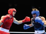 Denys Berinchyk (R) of Ukraine in action against Jeffrey Horn of Australia during the Men's Light Welter (64kg) Boxing quarterfinals on Day 12 of the London 2012 Olympic Games at ExCeL on August 8, 2012 in London, England.