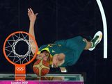 Matt Nielsen #14 of Australia lays the ball up in the first half against the United States during the Men's Basketball quaterfinal game on Day 12 of the London 2012 Olympic Games at North Greenwich Arena on August 8, 2012 in London, England.