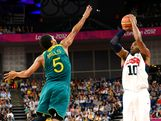 Kobe Bryant #10 of United States shoots over Patrick Mills #5 of Australia in the third quarter during the Men's Basketball quaterfinal game on Day 12 of the London 2012 Olympic Games at North Greenwich Arena on August 8, 2012 in London, England.