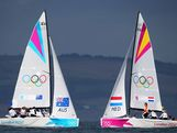 Olivia Price, Nina Curtis and Lucinda Whitty of Australia and Renee Groeneveld, Annemieke Bes and Marcelien Bos-De Koning of Netherlands compete in the Women's Elliott 6m WMR Sailing on Day 12 of the London 2012 Olympic Games at the Weymouth & Portland Venue at Weymouth Harbour on August 8, 2012 in Weymouth, England.