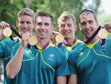 Murray Stewart, Dave Smith, Jacob Clear and Tate Smith of Australia hold up their Gold medals after the Men's Kayak Four (K4) 1000m Canoe Sprint at Eton Dorney on August 9, 2012 in Windsor, England.