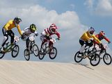 (L-R)  Brian Kirkham of Australia, Carlos Mario Oquendo Zabala of Colombia, Maris Strombergs of Latvia, Sam Willoughby of Australia and Twan van Gendt of the Netherlands clear a jump during the Men's BMX Cycling Quarter Finals on Day 13 of the London 2012 Olympic Games at BMX Track on August 9, 2012 in London, England.
