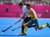 LONDON, ENGLAND - AUGUST 09:  Jamie Dwyer of Australia competes with Christopher Wesley of Germany during the Men's Hockey Semi Final match between Australia and Germany on Day 13 of the London 2012 Olympic Games at Riverbank Arena Hockey Centre on August 9, 2012 in London, England.