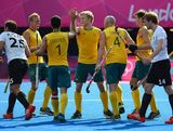 LONDON, ENGLAND - AUGUST 09:  Glenn Turner of Australia celebrates scoring his team's second goal with his team mates during the Men's Hockey Semi Final match between Australia and Germany on Day 13 of the London 2012 Olympic Games at Riverbank Arena Hockey Centre on August 9, 2012 in London, England.