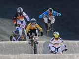 Brian Kirkham (C) of Australia races during the Men's BMX Cycling Quarter Finals on Day 13 of the London 2012 Olympic Games at BMX Track on August 9, 2012 in London, England.