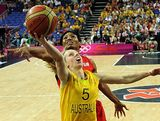 US guard Angel McCoughtry (back) challenges Australian guard Samantha Richards during the London 2012 Olympic Games women's semifinal basketball game bewteen Australia and the USA on Day 13 of the London 2012 Olympics Games at North Greenwich Arena on August 9, 2012 in London, England.