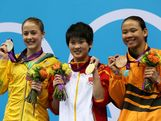 Silver medallist Brittany Broben of Australia, gold medallist Ruolin Chen of China, and bronze medallist Pandelela Pamg of Malaysia pose on the podium during the medal ceremony for the Women's 10m Platform Diving Final on Day 13 of the London 2012 Olympic Games at the Aquatics Centre on August 9, 2012 in London, England.