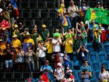 Fans of team Australia celebrate their 2-0 win over China during the Women's Hockey classification match for 5th and 6th place between Australia and China on Day 14 of the London 2012 Olympic Games at the Riverbank Arena Hockey Centre on August 10, 2012 in London, England.