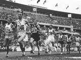 Berlin 1936: American Glenn Cunningham #746 is being chased by John Lovelock #467 of New Zealand during the men's 1,500m event. Lovelock eventually overtook and won the gold medal and Cunningham took the silver medal.