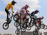 Khalen Young (L) of Australia trails the field across a jump in the Men's BMX Cycling Semi Finals on Day 14 of the London 2012 Olympic Games at the BMX Track on August 10, 2012 in London, England.