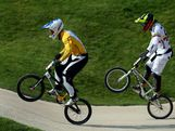 Sam Willoughby (L) of Australia and Carlos Mario Oquendo Zabala of Colombia race over a jump in the Men's BMX Cycling Semi Finals on Day 14 of the London 2012 Olympic Games at the BMX Track on August 10, 2012 in London, England.