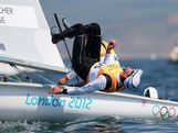 Malcolm Page of Australia celebrate after winning gold with team mate Mathew Belcher in the Men's 470 Sailing on Day 14 of the London 2012 Olympic Games at the Weymouth & Portland Venue at Weymouth Harbour on August 10, 2012 in Weymouth, England.