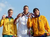 (L-R) Silver medallist Sam Willoughby of Australia, Gold medallist Maris Strombergs of Latvia, and Bronze medallist Carlos Mario Oquendo Zabala of Colombia celebrate during the medal cermony for the Men's BMX Cycling Final on Day 14 of the London 2012 Olympic Games at the BMX Track on August 10, 2012 in London, England.