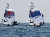 Mathew Belcher and Malcolm Page of Australia and Luke Patience and Stuart Bithell of Great Britain compete in the Men's 470 Sailing on Day 14 of the London 2012 Olympic Games at the Weymouth & Portland Venue at Weymouth Harbour on August 10, 2012 in Weymouth, England.
