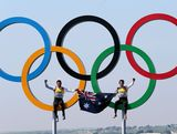 Mathew Belcher (R) and Malcolm Page (L) of Australia celebrate in the Olympic rings after winning gold in the Men's 470 Sailing on Day 14 of the London 2012 Olympic Games at the Weymouth & Portland Venue at Weymouth Harbour on August 10, 2012 in Weymouth, England.