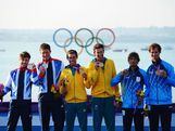 Silver medallists Luke Patience and Stuart Bithell of Great Britain, gold medallists Mathew Belcher and Malcolm Page of Australia and bronze medallists Lucas Calabrese and Juan De La Fuente of Argentina celebrate following the Men's 470 Sailing on Day 14 of the London 2012 Olympic Games at the Weymouth & Portland Venue at Weymouth Harbour on August 10, 2012 in Weymouth, England.