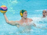 Billy Miller #12 of Australia throws a pass in the Men's Water Polo Semifinal 5-8 match between Hungary and Australia on Day 14 of the London 2012 Olympic Games at the Water Polo Arena on August 10, 2012 in London, England.