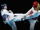 Helena Fromm (L) of Germany competes against Carmen Marton of Australia in the Women's -67kg Taekwondo Bronze Medal Finals bout on Day 14 of the London 2012 Olympic Games at ExCeL on August 10, 2012 in London, England.