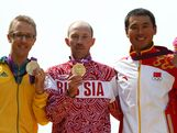 (L-R) Silver medalist Jared Tallent of Australia, gold medalist Sergey Kirdyapkin of Russia and bronze medalist Tianfeng Si of China pose during the medal ceremony for the Men's 50km Walk on Day 15 of the London 2012 Olympic Games on The Mall on August 11, 2012 in London, England.
