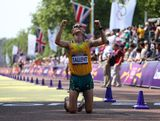 Jared Tallent of Australia celebrates after crossing the finish line and claiming silver in the Men's 50km Walk on Day 15 of the London 2012 Olympic Games on the streets of London on August 11, 2012 in London, England.