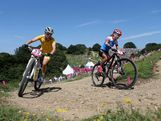 Emiliy Batty of Canada and Rebecca Henderson of Australia during the Women's Cross-country Mountain Bike race on Day 15