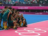 The Hockeyroos celebrate their victory against Great Britain and pose for a photograph after the Men's Hockey bronze medal match on Day 15