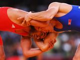 Farzad Tarash of Australia in action against Didier Pais of France in the Men's Freestyle Wrestling 60kg 1/8 final match on Day 15 of the London 2012 Olympic Games at ExCeL on August 11, 2012 in London, England.
