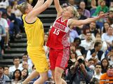 Suzy Batkovic #8 of Australia attempts a shot against Nadezhda Grishaeva #15 of Russia during the Women's Basketball Bronze Medal game on Day 15 of the London 2012 Olympic Games at North Greenwich Arena on August 11, 2012 in London, England.