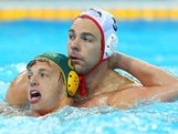 Richie Campbell of Australia and Peter Hudnut of United States tussle in the Men's Classification 7th-8th place match between the United States and Australia on Day 16 of the London 2012 Olympic Games at the Water Polo Arena on August 12, 2012 in London, England.