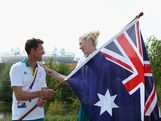 Lauren Jackson Captain of the Australian Women's basketball team poses with closing cermony flag bearer, gold medallist sailor Malcolm Page (L) during an Australian flag handover at the Olympic Park Common Domain on Day 16