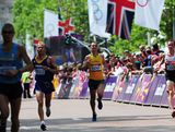 (L-R)  Marius Ionescu of Romania, Martin Dent of Australia and Reid Coolsaet of Canada approach the finish line in the Men's Marathon on Day 16 of the London 2012 Olympic Games at The Mall on August 12, 2012 in London, England.