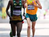 (L-R) Wirimai Juwawo of Zimbabwe and Michael Shelley of Australia approach the finish line in the Men's Marathon on Day 16 of the London 2012 Olympic Games at The Mall on August 12, 2012 in London, England.